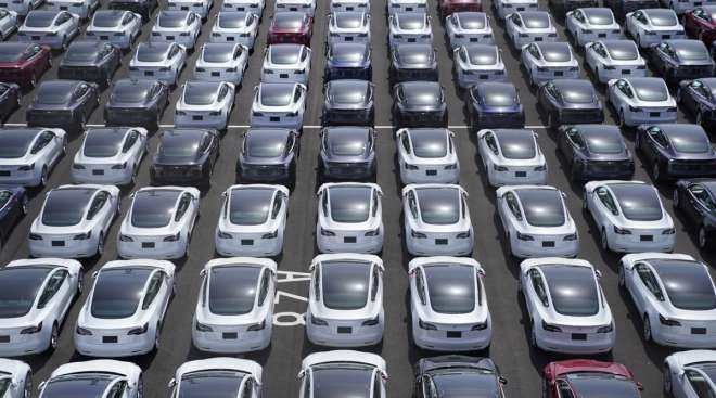 Tesla vehicles sit in a lot after arriving at a port in Japan. (Toru Hanai/Bloomberg News)