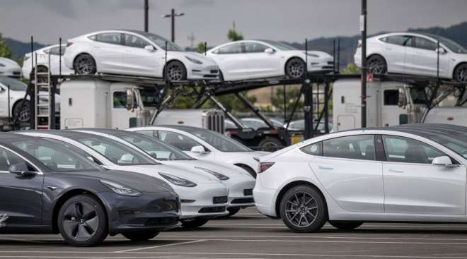 Tesla vehicles are parked at the company's assembly plant in Fremont, Calif., on May 11.
