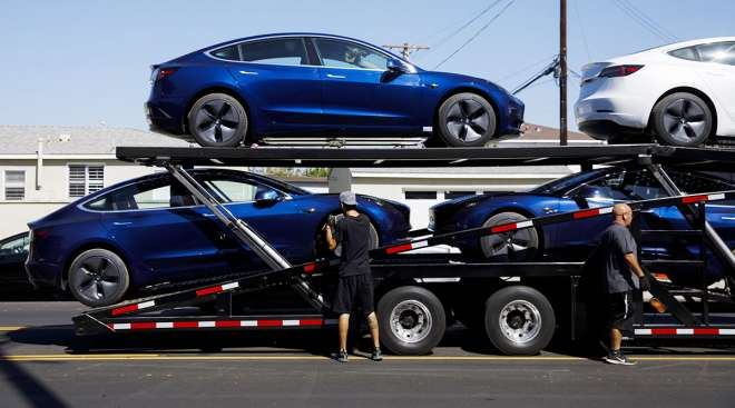 Tesla cars on trailer