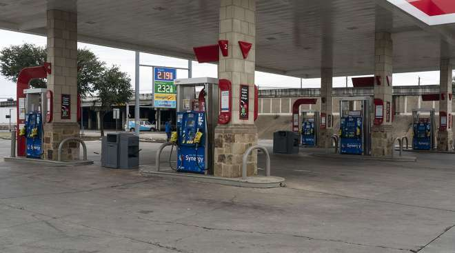 Gas pumps are out of service at an Exxon gas station in Houston Feb. 18. (Go Nakamura/Getty Images via Bloomberg News)
