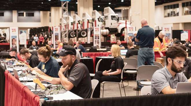 Competitors take the written test at 2019 TMC's SuperTech event