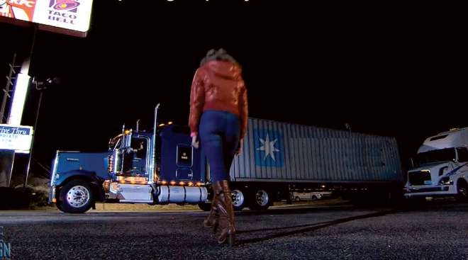 Woman approaching truck at truck stop