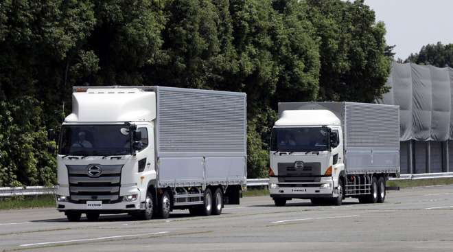 Hino Motors autonomous trucks travel in convoy during a demonstration in Japan.