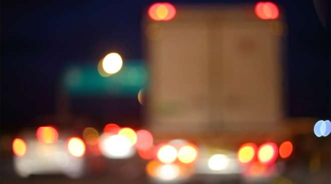Truck on road at night