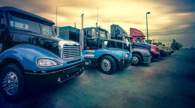 Sunset behind trucks at a rest stop