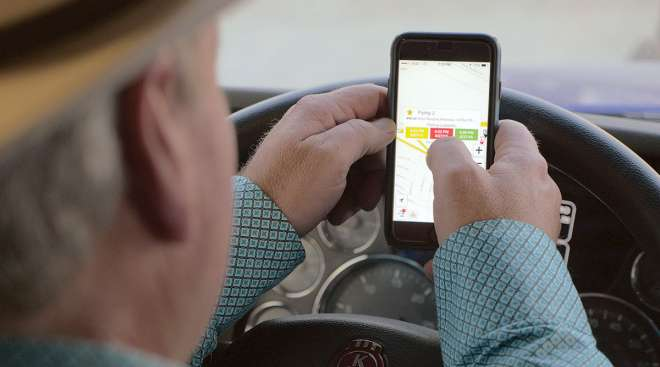 A driver uses the Trucker Path Pro mobile app