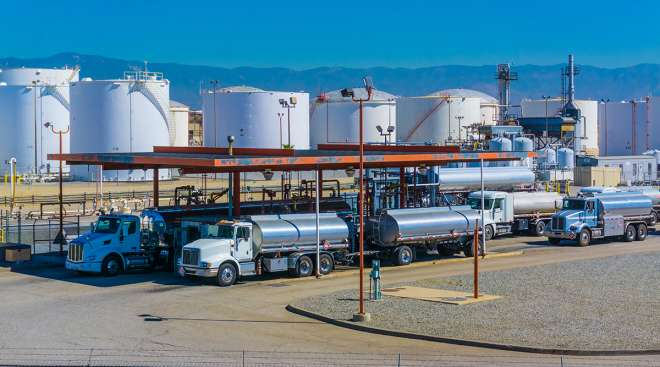 Fuel tanker trucks at a California refinery fueling station