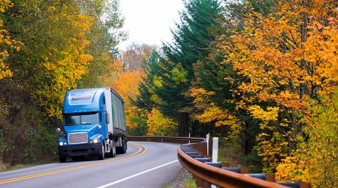 Truck on road with fall colors