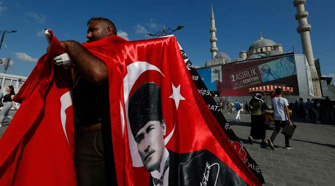 A street vendor offers Turkish flags for sale at a market in Istanbul