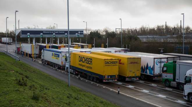 Trucks wait at the check-in for the channel tunnel in Folkestone, U.K.