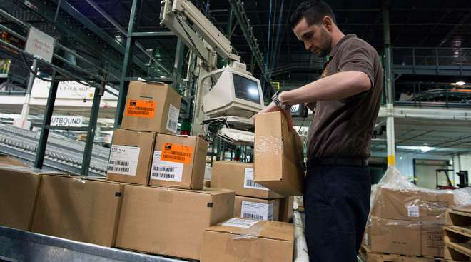 A UPS worker at a distribution center