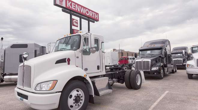 A 2016 Kenworth T270 flatbed truck