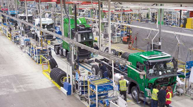 Trucks roll on assembly line at a Volvo plant in Sweden