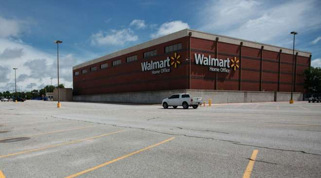 A nearly empty parking lot stands outside the Walmart World Headquarters in Bentonville, Ark., on Ma