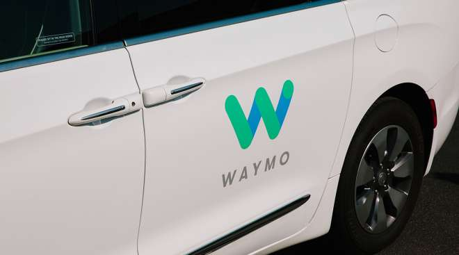 Waymo signage on the door of a Chrysler Pacifica autonomous vehicle