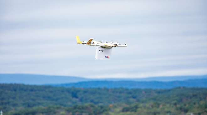 Drone carrying a FedEx package