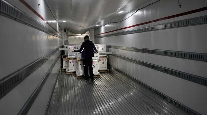 Pfizer vaccines loaded on truck