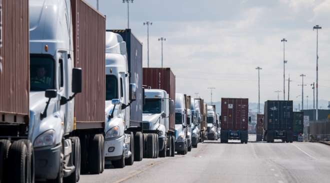 Trucks wait in line to enter the Port of Oakland in March 2020. (David Paul Morris/Bloomberg News)