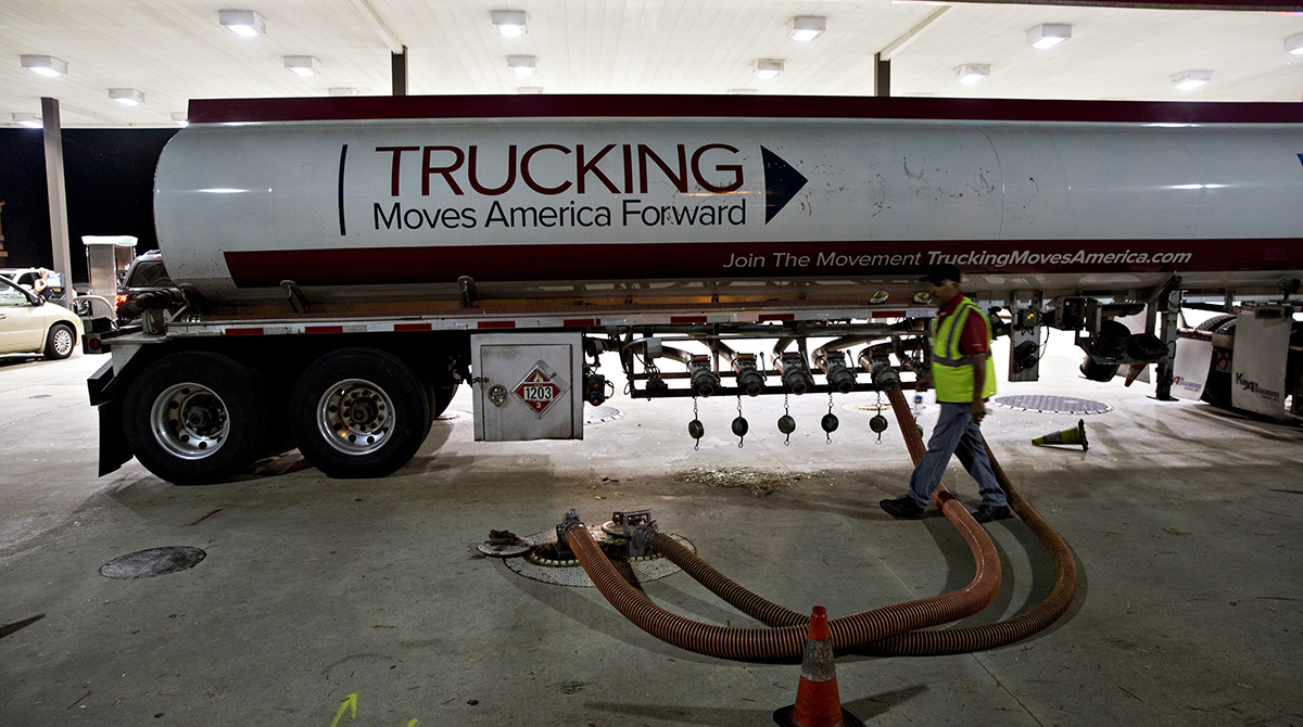 A gas tanker truck delivers fuel to a gas station in Estero, Fla., U.S., on Tuesday, Sept. 12, 2017.