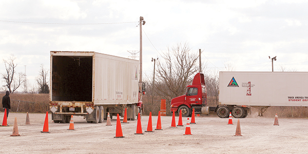 Students practice their skills at the Truck Training America commercial driving school in Shepherdsville, Ky.