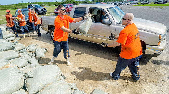 St. Bernard Parish Sheriff's Office inmate workers move free sandbags for residents in Chalmette, La.