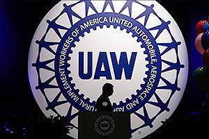 UAW logo behind podium