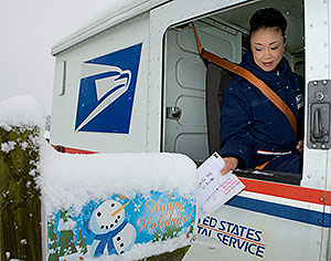 Mail carrier delivers to box