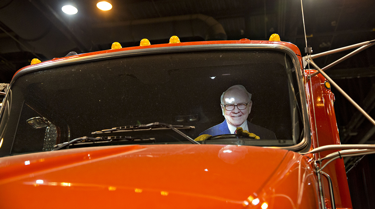 A cardboard cutout in the likeness of Warren Buffett, chairman and CEO of Berkshire Hathaway Inc., sits in the driver's seat of a truck on display during the Berkshire Hathaway annual meeting in Omaha, Neb.