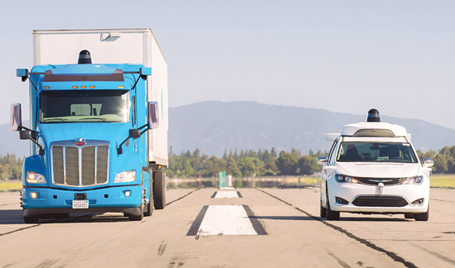Waymo truck and car